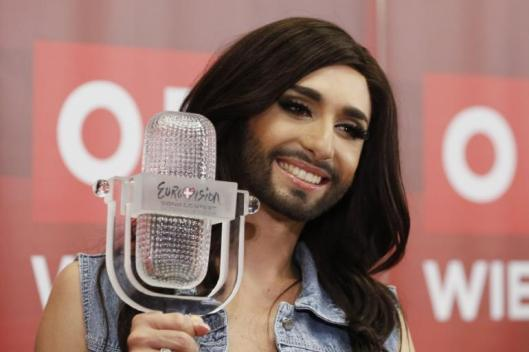 446291-austrias-conchita-wurst-poses-with-her-trophy-after-a-news-conference-
