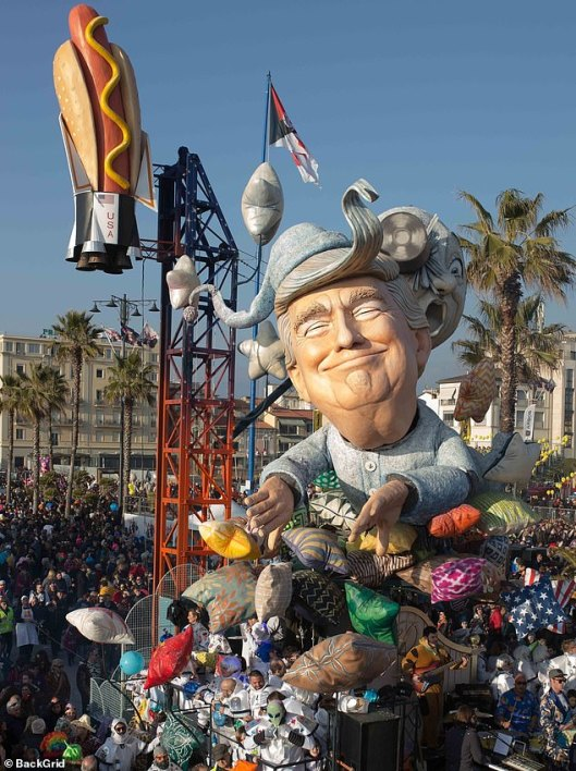 9988868-6719861-Another_float_at_the_festival_depicted_a_grinning_Trump_in_pyjam-a-3_1550571920113